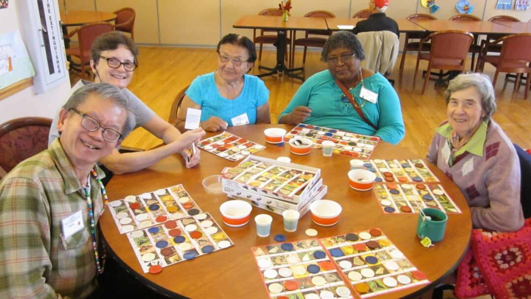 five Avenidas members play bird bingo at the Avenidas Rose Kleiner Center