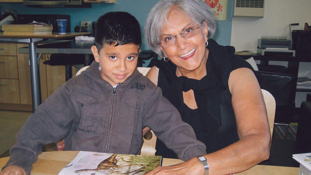 Avenidas Volunteer with early literacy program student