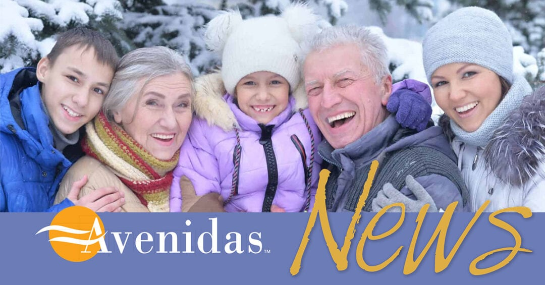 Family outdoors in the snow: grandson, grandmother, granddaughter, grandfather, and his daughter