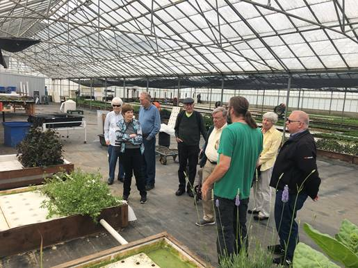 Avenidas VIllage members visiting Ouroboros Aquaponics