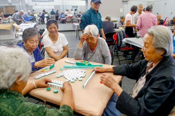 Chinese women playing Mahjong at the Avenidas Chinese Community Center