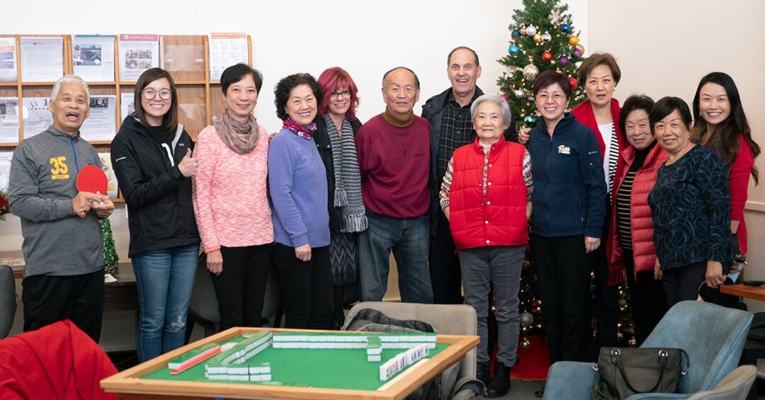 The Avenidas Chinese Community Center staff and community celebrating Christmas