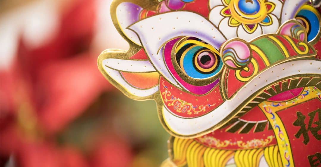 detail of a Chinese dragon mask with blurred background