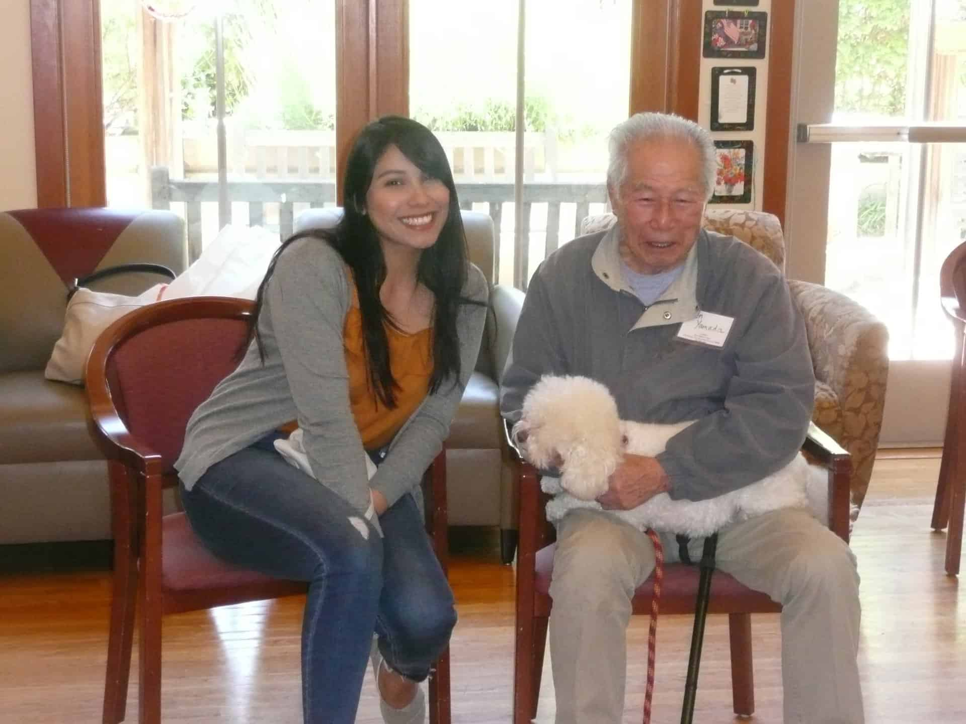 Arlene Esquivias and her therapy dog Minnie visit Avenidas