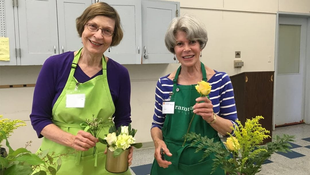 Avenidas Blooms volunteers creating bouquets