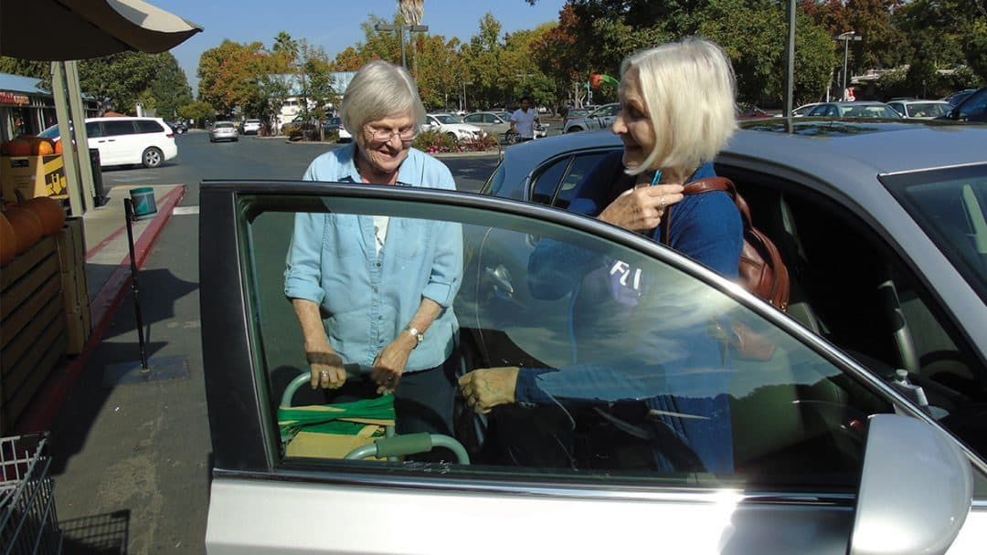 volunteer driver opening the door for her passenger
