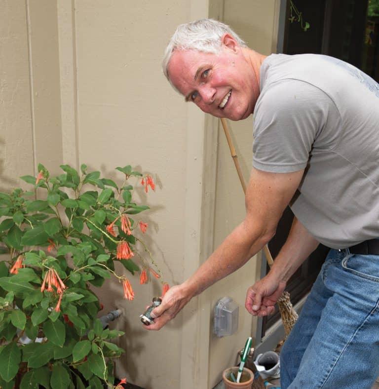 Avenidas handyman fixing an outdoor faucet