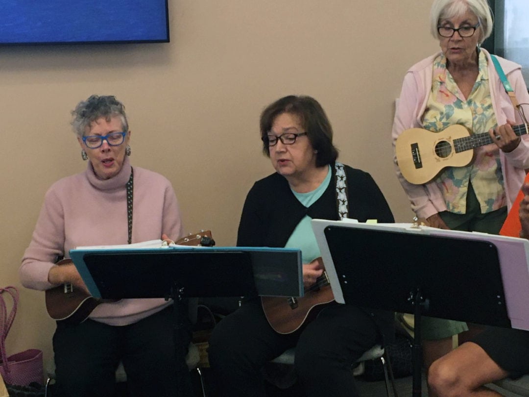 Members of the Uku-u-Ladies play their ukuleles at the Avenidas 50th birthday bash