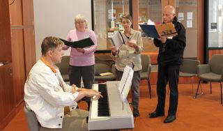 Michael Strehlo-Smith with members of the Avenidas Choir