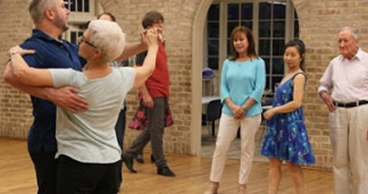 Avenidas members at a ballroom dance class