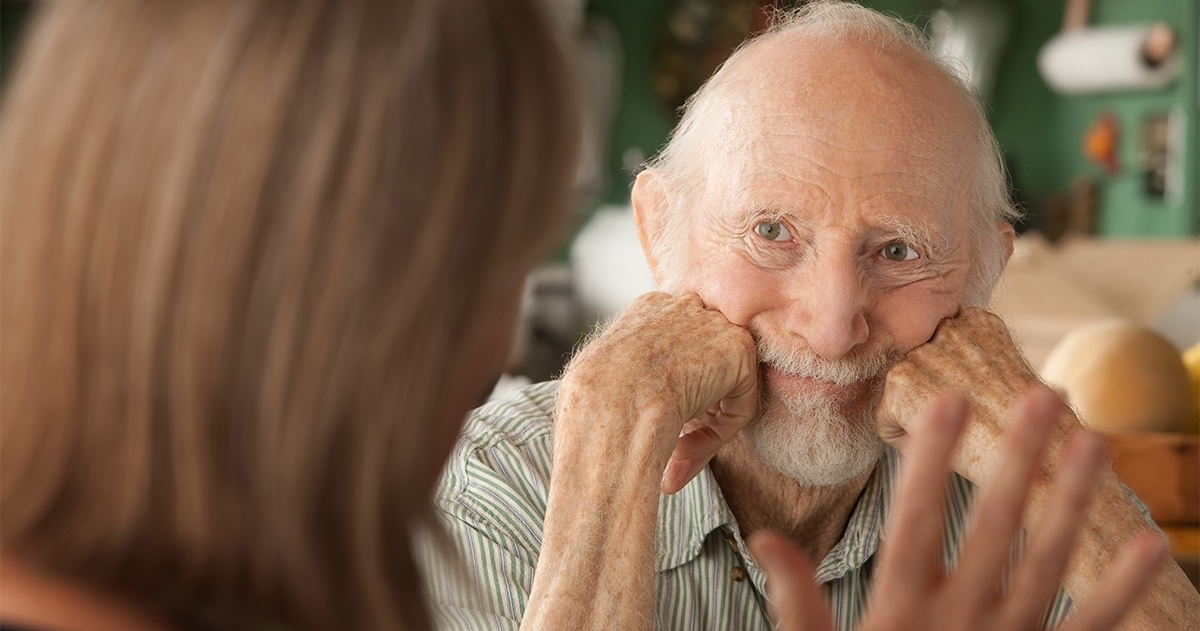 senior couple focusing on man's face