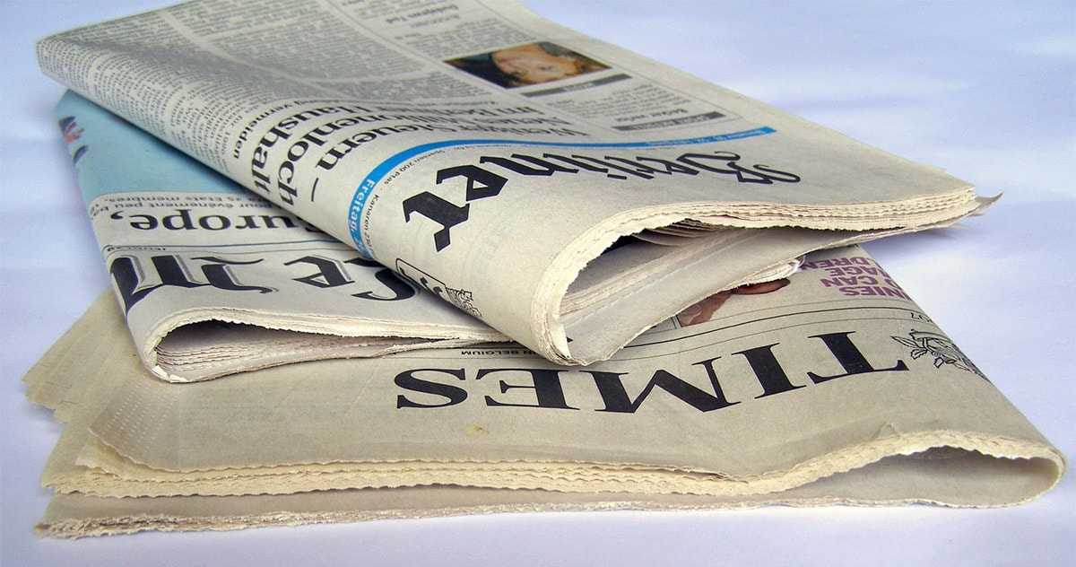 stack of three newspapers: Times of London, Le Monde, and Berliner Zeitung