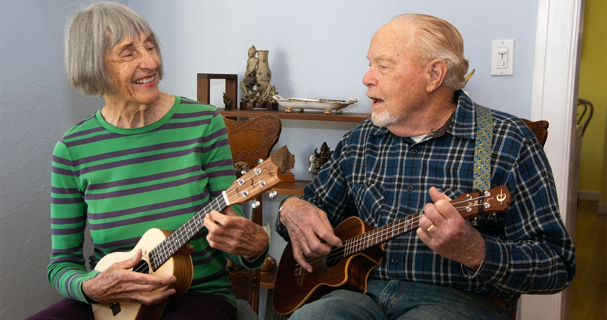 P.A. Moore and husband Ed leading the Ukulele Jam Session via Zoom from their home