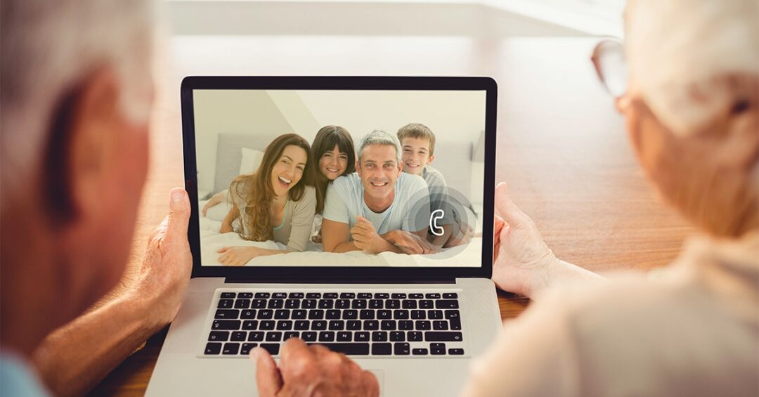senior couple having a video call with their family