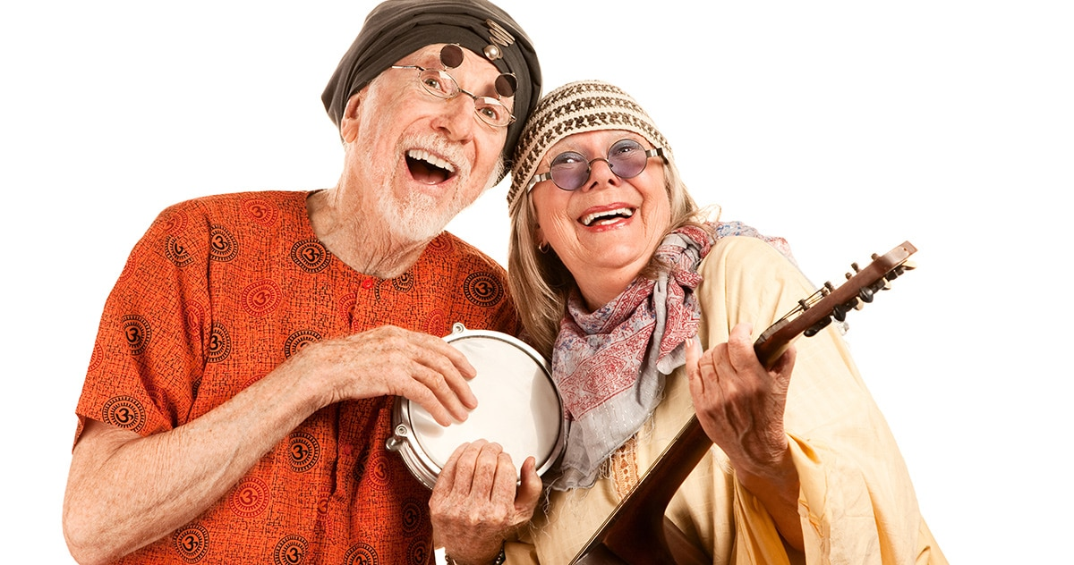 older couple clowning around dressed as hippies