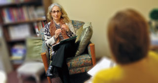 Paula Wolfson consulting in her office