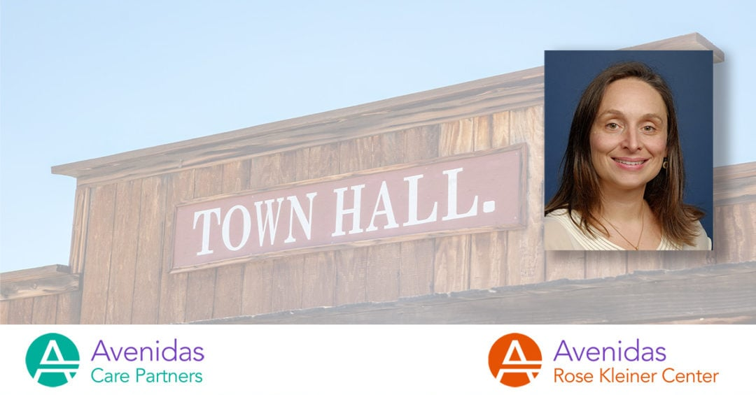 """photo of Dr. Marina Martin on backdrop that says """"Town Hall"""""""