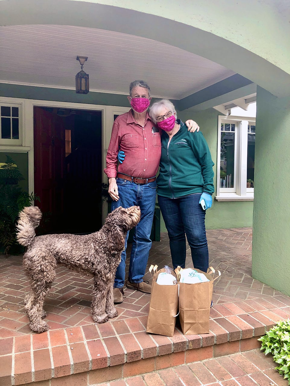 Avenidas Village members (and their dog) receive a no-contact grocery delivery
