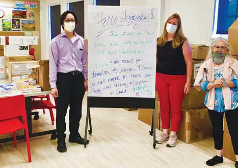 Dr. Albert Lam, left, and Jyllian Halliburton, volunteer director at Avenidas, and Paula Wolfson, manager of Avenidas Care Partners, inventory personal protective equipment that has been donated to Operation PPE.
