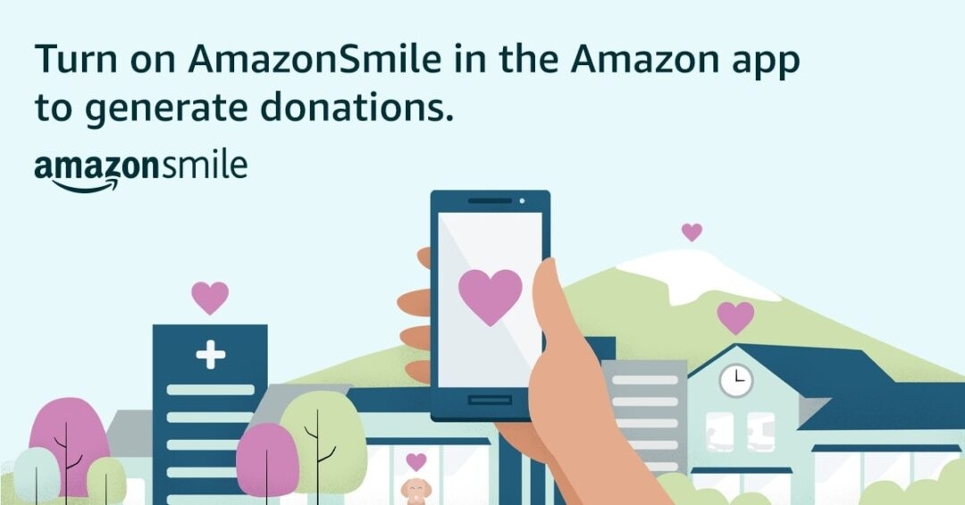 "Illustration of a hand holding a phone, with the text ""Turn on AmazonSmile in the Amazon app to generate donations"""