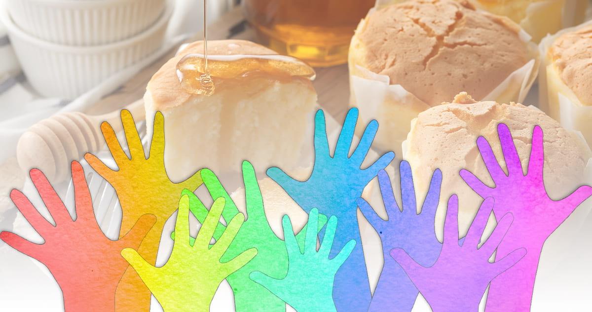 rainbow colored hands raised to volunteer, superimposed on photo of breakfast rolls