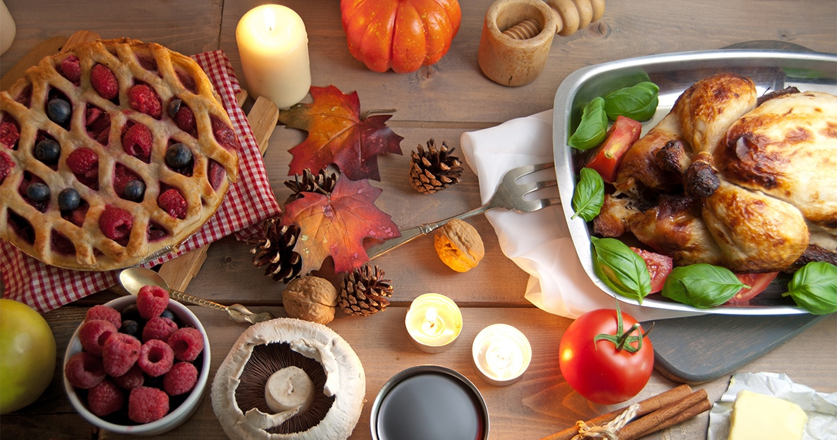 Thanksgiving dinner with turkey, pie, fruit, and decorative candles