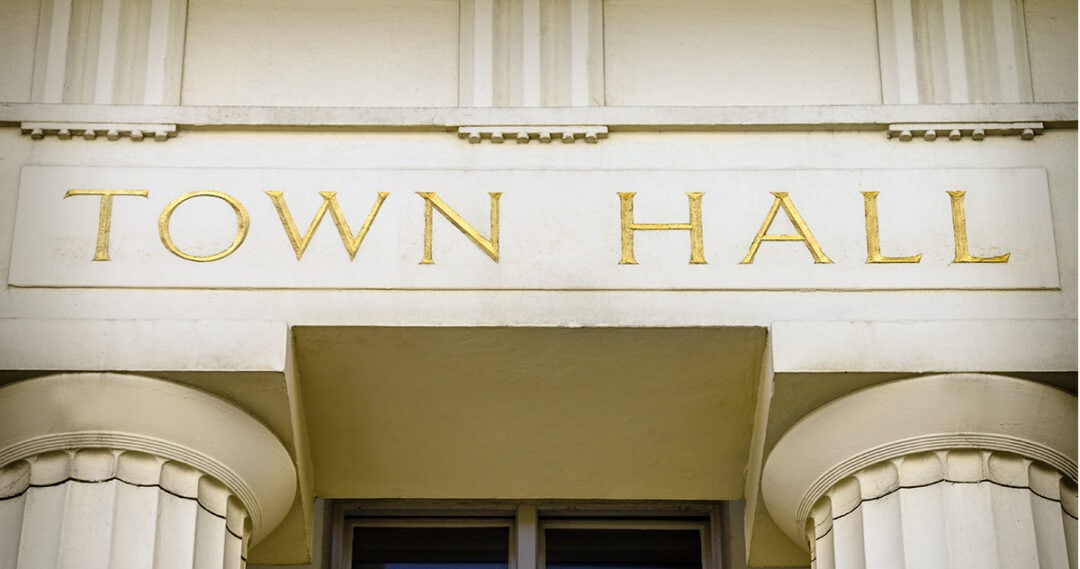 detail of the front of a Greek Revival town hall building