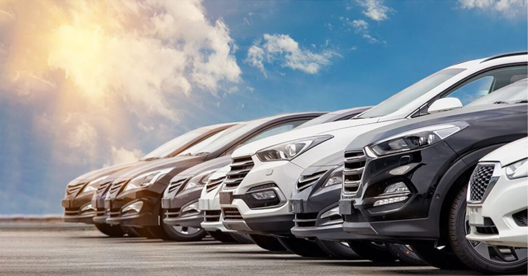 New cars lined up at a car dealership